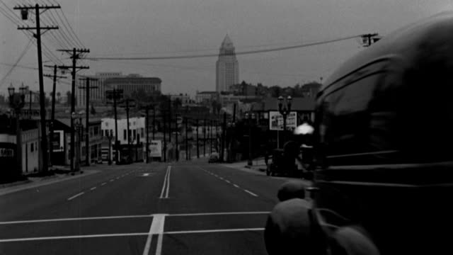 a coroner's van travels on a city street toward downtown beverly hills, california. - 1949 stock videos & royalty-free footage
