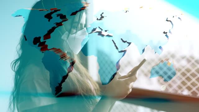 コロノウイルス 2019-ncov 背景概念.世界地図オーバーレイと保護マスクを身に着けている忍耐。 - rnaウイルス点の映像素材/bロール