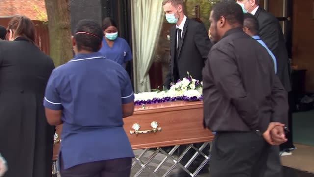 friends and family celebrate the life of care home nurse and covid19 victim elsie sazuze england west midlands ext colleague of care home nurse elsie... - coffin stock videos & royalty-free footage