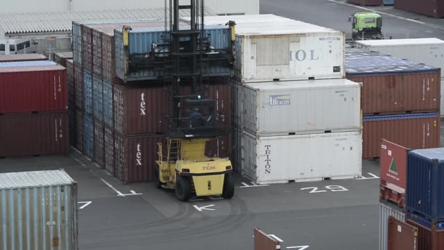 corp straddle carrier stacks a container at a shipping terminal in yokohama japan on monday dec 15 2014 - straddle carrier stock videos & royalty-free footage