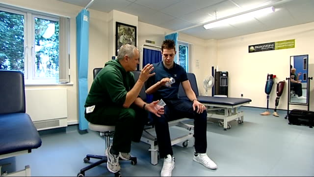 corporal andrew garthwaite with artificial arm and interview england surrey headley court defence medical rehabilitation centre int various of... - potting stock videos and b-roll footage