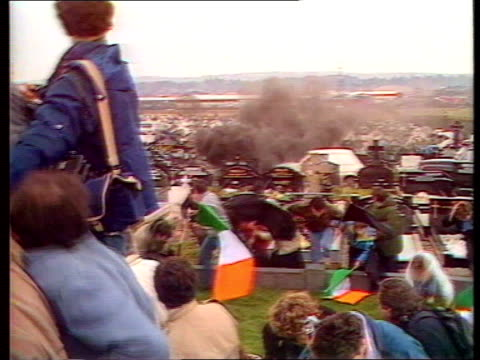 Corporals murder convictions NORTHERN IRELAND Corporals murder convictions ITN LIB Belfast Milltown Cemetery LS Grenade explosion amidst mourners LS...