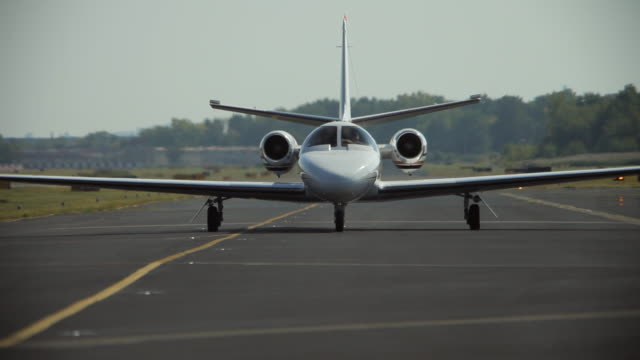 corporate aircraft taxi at teterboro airport - jackson new jersey stock videos and b-roll footage