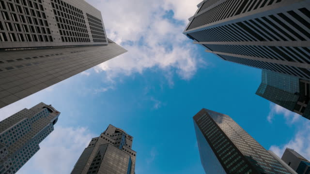 Corporate buildings and cloudy sky