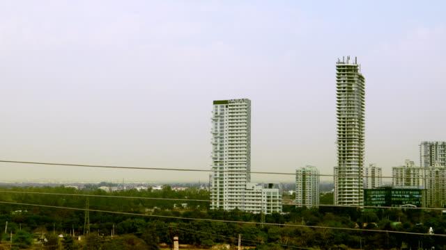 corporate business building in gurugram, haryana, india - haryana stock videos & royalty-free footage