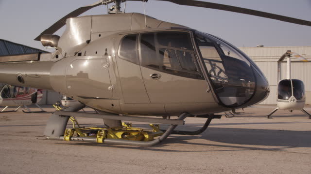 PAN corporate helicopter being moved on motorized trolley, RED R3D 4K