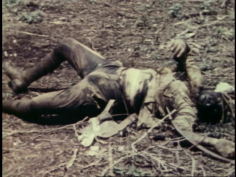 Corpses and body parts lying on ground / Guam