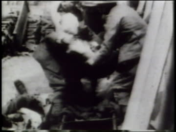 corpses litter world war i battlefields; wounded survivors are pushed through the streets in wheelchairs. - world war one stock videos & royalty-free footage