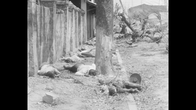 vs corpses of dead filipinos killed at the hands of the japanese lie on ground near wall of building in the intramuros area of manila / vs dead... - isola di luzon video stock e b–roll