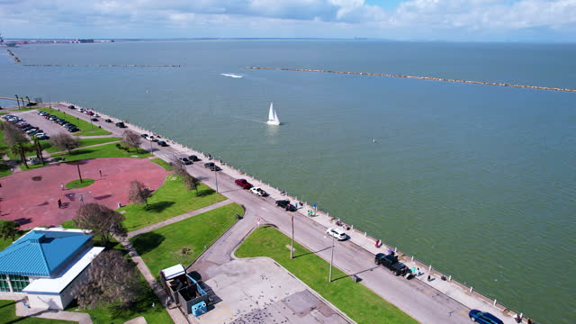 corpus christi harbor drone view fly over moving towards sailboat on the bay - corpus christi texas stock videos & royalty-free footage