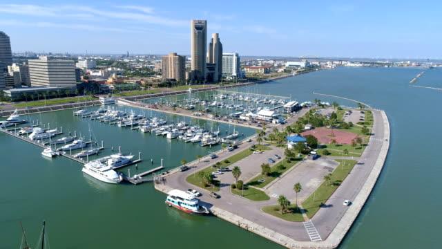 corpus christi , texas , usa aerial drone view above the t-head marina on a nice sunny day - corpus christi texas stock videos & royalty-free footage