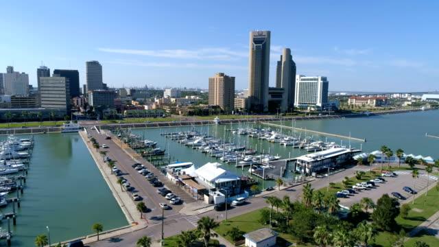 corpus christi , texas , usa aerial drone view side pan across the downtown marina - corpus christi texas stock videos & royalty-free footage