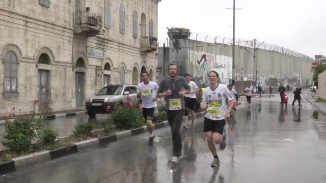 correctedhundreds of athletes on sunday braved freezing rain to take part in bethlehems first ever marathon which started at the nativity church and... - church of the nativity stock videos and b-roll footage