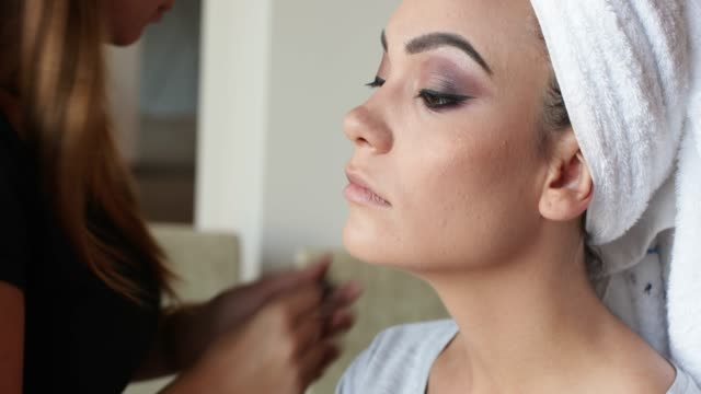correcting eye make-up with lash and brow comb - beauty queen stock videos and b-roll footage