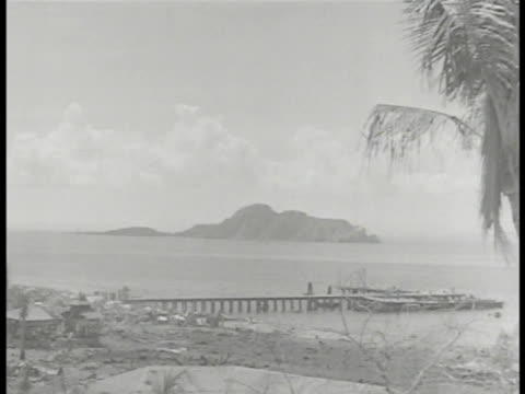 caballo island w/ navy dock. two japanese soldiers, one using binoculars. japanese attack: soldiers cleaning shell, sitting, cannon lowering, rapidly... - filippine video stock e b–roll