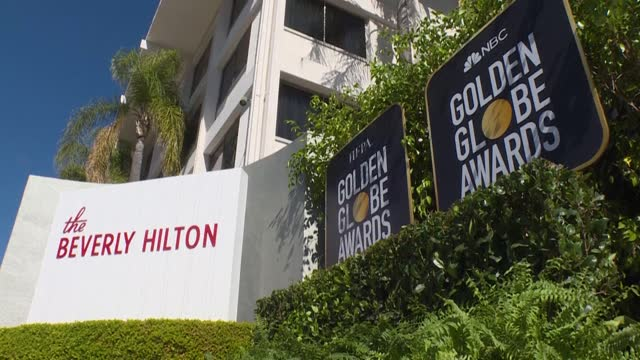 correspondent tapes a segment in front of the beverly hilton a few days ahead of the golden globes ceremony, where media access is restricted this... - the beverly hilton hotel stock videos & royalty-free footage