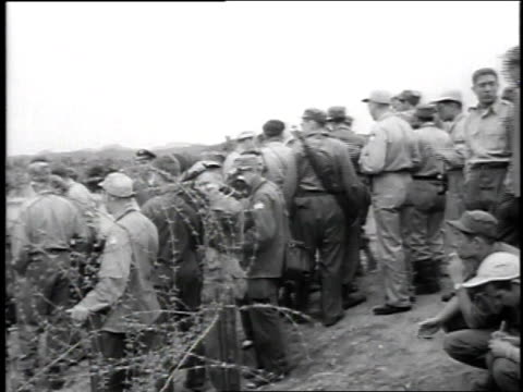 correspondents waiting for helicopter / helicopter landing / correspondents running to helicopter upon landing - 1951 stock videos & royalty-free footage