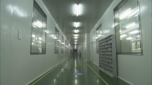 ws corridor at suntech power holdings factory, wuxi, jiangsu, china - fluorescent light stock videos and b-roll footage