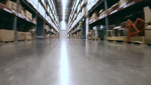 corridor in megastore/warehouse with packages - megastore stock videos & royalty-free footage