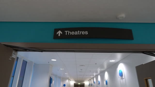corridor leading to operating theatre in royal london hospital, including relevant signs - operating theatre stock videos & royalty-free footage