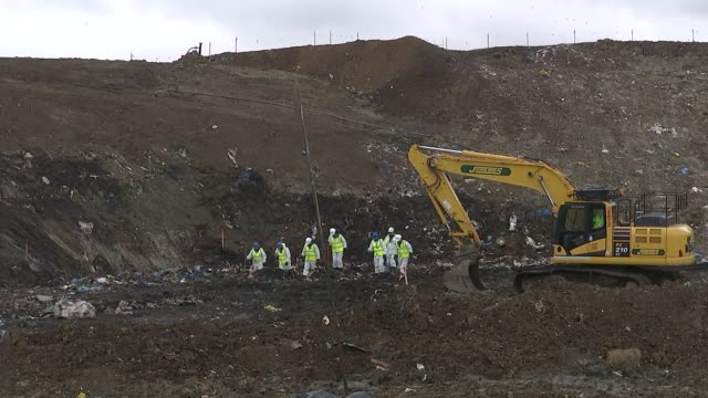 police search landfill site england cambridgeshire milton ext various of police officers with mechanical digger searching landfill site for the body... - bury st edmunds stock videos & royalty-free footage