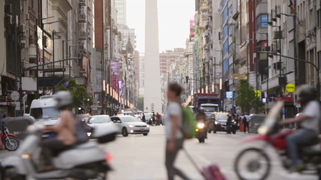 corrientes avenue buenos aires with obelisk - argentinian culture stock videos & royalty-free footage
