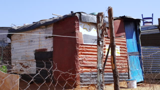 MS Corrugated iron shack in township / Cosmo City, South Africa
