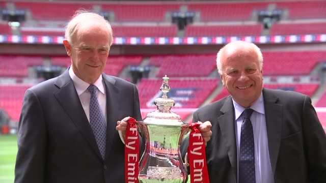blatter continues his defiance after reelection wembley stadium ext greg dyke and sir tim clark posing on pitch with the fa cup greg dyke interview... - greg dyke stock videos and b-roll footage