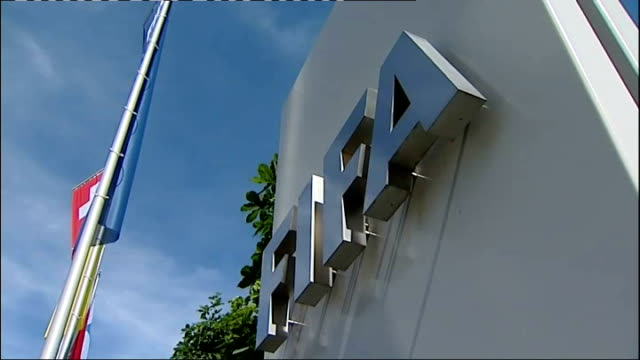 corruption scandal: jack warner resigns as vice-president; tx 31.5.2011 fifa sign on building at association's headquarters 'fifa fair play' flag - fifa stock videos & royalty-free footage