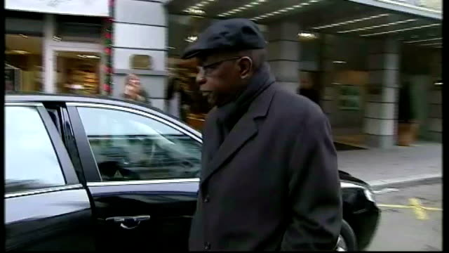 corruption scandal of bribes for votes for fifa presidency tx zurich ext jack warner along to car outside hotel as he ignores questions from... - fifa stock videos and b-roll footage