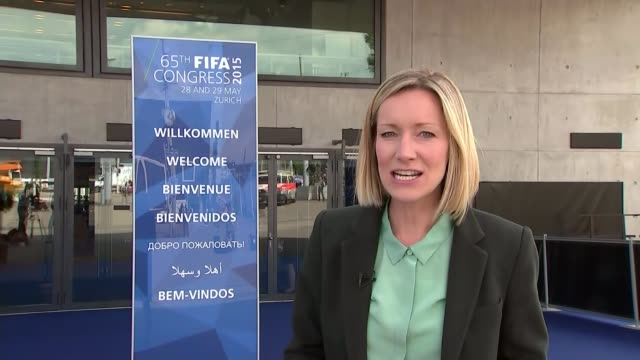 corruption scandal: sepp blatter re-elected as fifa president; reporter to camera/ omari selemani speakign to press at netering building sot - i will... - papier stock videos & royalty-free footage