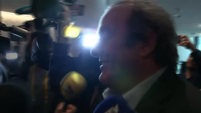 corruption scandal: sepp blatter refuses to resign / boycott threat; michel platini along with scrum of press around michel platini press... - fifa stock videos & royalty-free footage