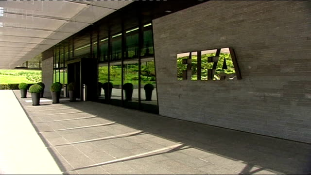 sepp blatter to be investigated switzerland zurich ext general view of fifa headquarters building close shot of fifa sign on building - fifa stock videos and b-roll footage