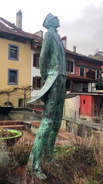 corto maltese statue overlooking the lavaux vineyard and lake geneva from the village of grandvaux - 1927 stock videos & royalty-free footage