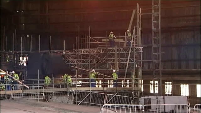 corus steel plant in redcar to re-start production; england: teesside: redcar: corus steelworks: int surveyors measuring up interior of empty blast... - 鋼点の映像素材/bロール