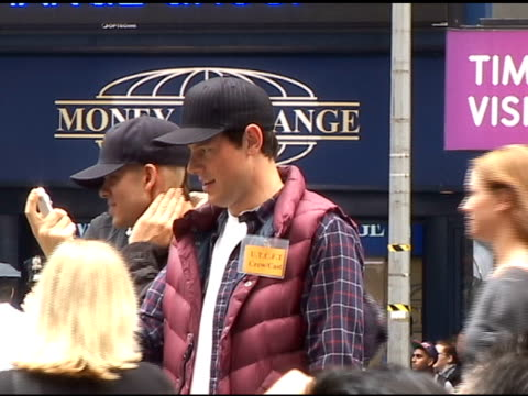 cory monteith takes pictures of fellow cast and crew while shooting the season finale of 'glee' in times square in new york 04/28/11 - cory monteith stock videos and b-roll footage