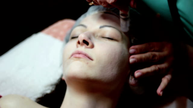 cosmetic treatment - head massage stock videos and b-roll footage