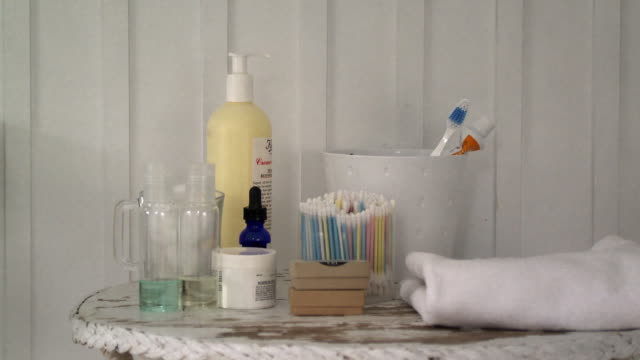 cu cosmetics on bathroom table, scarborough, new york, usa - toothbrush stock videos & royalty-free footage