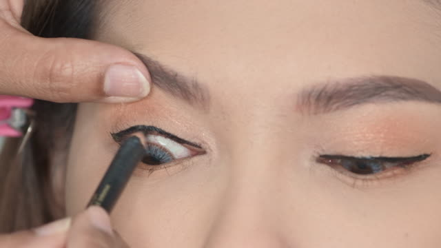 cosmetics on the face of a woman. - eyelid stock videos and b-roll footage