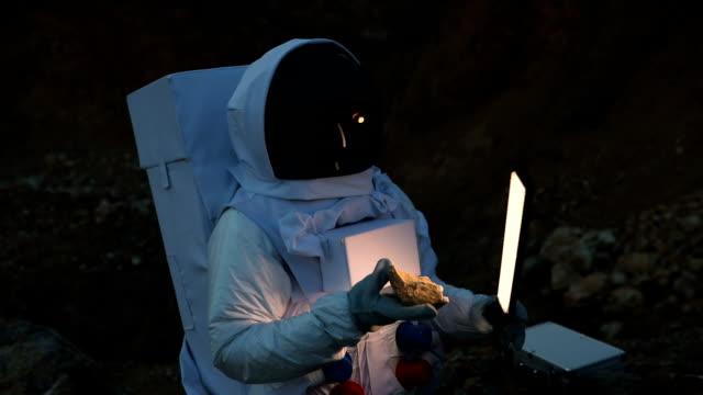 Cosmonaut exploring on dark planet