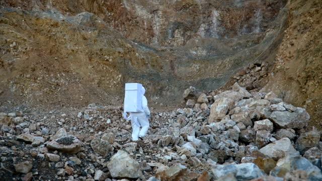 Cosmonaut exploring rocky Mars