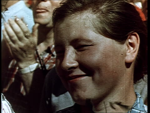 cosmonaut yuri gagarin first man in space jubilation in the streets cheering crowds back to moscow gagarin gets off the plane and walks on a red... - プロパガンダ点の映像素材/bロール