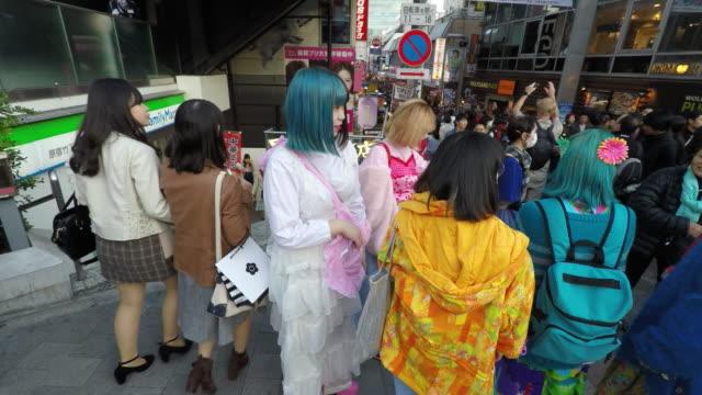 cosplayers in harajuku fashion district - 扮装点の映像素材/bロール