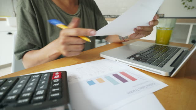 cost efficiency. - calculator stock videos & royalty-free footage