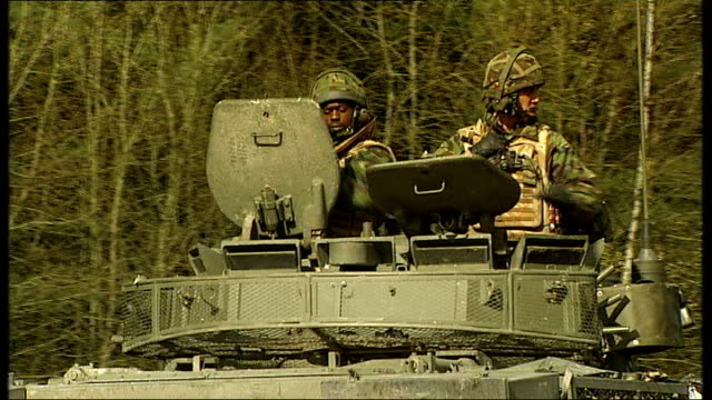 cost to britain of five years of war army tank caterpillar track along muddy ground british soldiers along in tank troops checking weapons - caterpillar track stock videos and b-roll footage