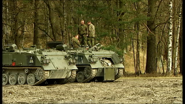british soldiers in army training exercise germany ext good shots british military helicopter flying along / various of british soldiers next... - caterpillar track stock videos and b-roll footage