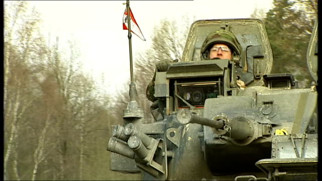 british soldiers in army training exercise various of british soldiers driving tanks along close up of caterpillar track in motion thru mud - caterpillar track stock videos and b-roll footage