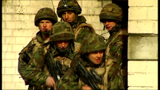 cost to britain of five years of war: british soldiers undertake combat training; day various of british soldiers training how to enter buildings in... - iraq stock videos & royalty-free footage
