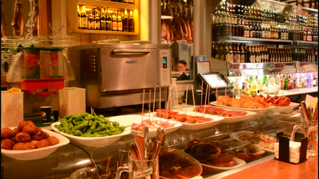 costa gallega tapas restaurant counter with food, barcelona spain - tapas stock videos & royalty-free footage