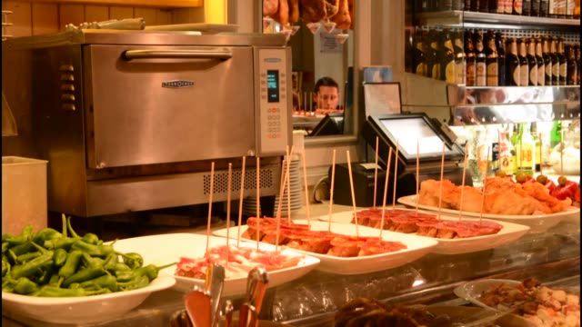 Costa Gallega Tapas Restaurant counter with food, Barcelona Spain